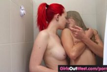 Attractive lesbian teenagers finger cunts in rest room