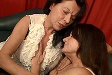 2 German grannies receive kinky in couch