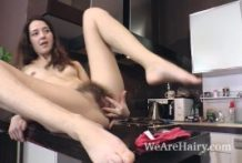 Lisa Carry unclothes bare and plays in her kitchen