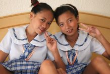 Two naughty Filipina schoolgirls devour pussy and get fucked